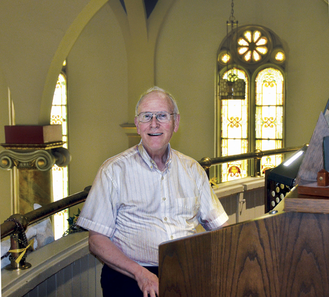Tom Smith, music director, organist, hand bell choir coordinator, Scout leader and parish icon, sits at the massive Kilgen organ in the choir loft at Cathedral of St. Joseph, where he has served for 38 years. (Marty Denzer/Key photo)