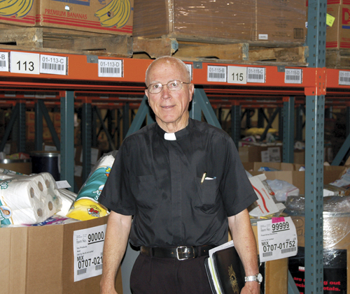 "Father Pat Tobin, one of the ""founding fathers"" of Harvesters, shown in the food bank's headquarters in 2007. (Marty Denzer/Key file photo)"