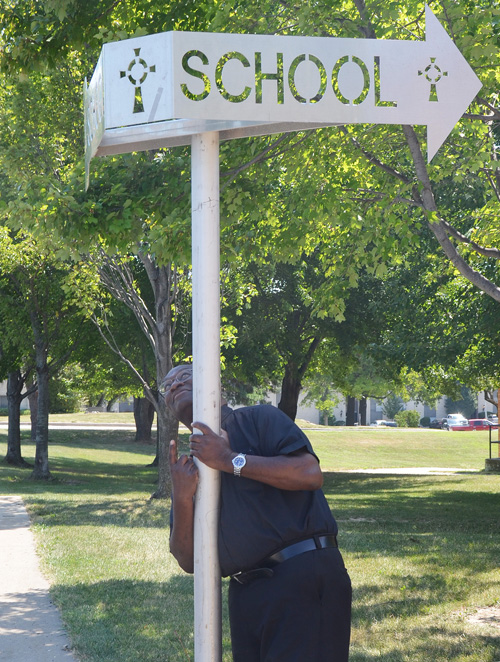 Father Robert Stewart finally has a parish with a school. He looks forward to a great school year for St. Patrick's students and teachers. (Marty Denzer/Key photo)