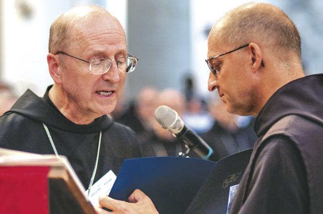 Abbot Primate Gregory Polan reads the Profession of Faith. (Photo - Br. Simon Stubbs, O.S.B., St. Anelsmo)