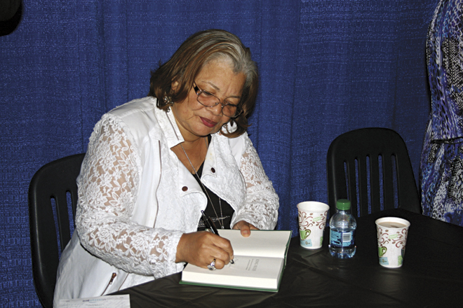 Dr. Alveda King autographs her book following her speech at the St. Joseph PRC fundraiser. (photo courtesy Sara Kraft)