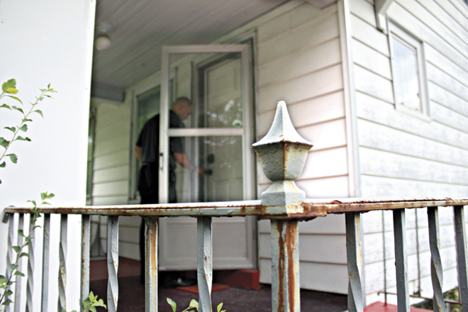 Director of Housing Development Jarrod Sanderson unlocks the door of the first home donated to the Neighborhoods of Hope project.  (photo courtesy of Catholic Charities)
