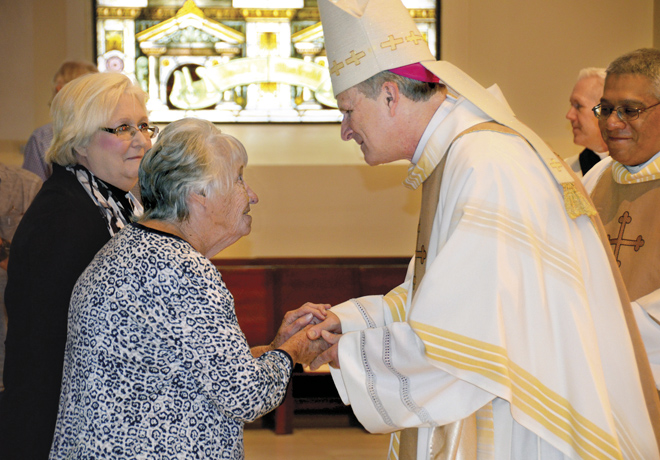 In gratitude for willing service to their parish or school, Bishop Johnston presents each honoree with a token of appreciation during the Recognition Mass Sept. 25 at the Cathedral of the Immaculate Conception. (Marty Denzer/Key photo)