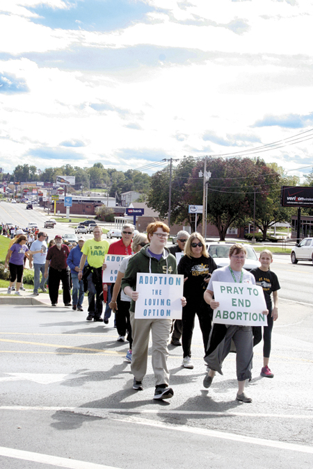 Life Day walkers carry signs showing their support along the Belt Highway. (Sara Kraft/Key photo)
