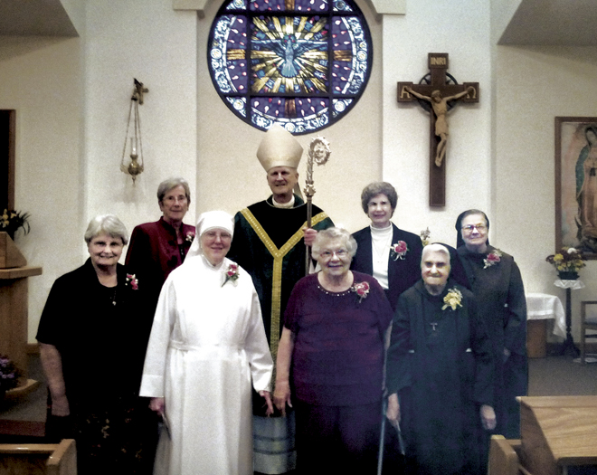 Bishop Johnston poses with the Religious Jubiliarians. They  are front row l to r: Sister Mary Clare Gappa, SCL; Sister Anastasia Mary Miller, lsp; Sister Martha Niemann, CSJ; Sister Mary Madonna Gieselman, OSF. Back row l to r: Sister Jeanne Jansen, CSJ; Bishop Johnston; Sister Antonella Bayer, CSJ; Sister Andrea Kantner, OSF. (Key photo/courtesy Sister Connie Boulch OSF)