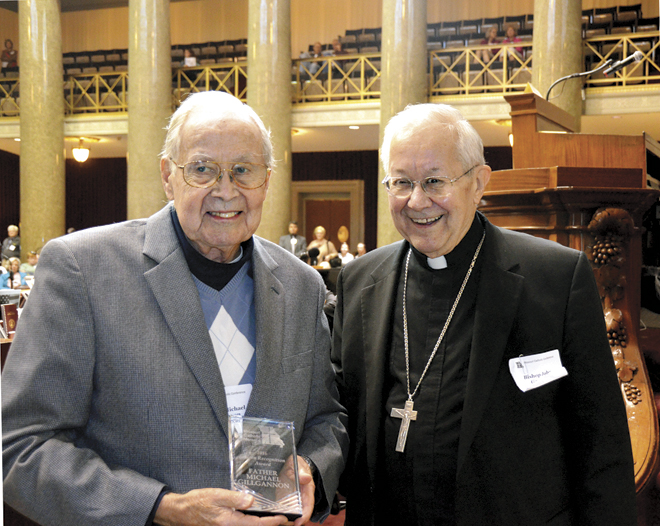 Father Michael Gillgannon, recipient of the MCC Citizen Recognition Award, smiles with Bishop John Gaydos of Jefferson City. (Marty Denzer/Key photo)
