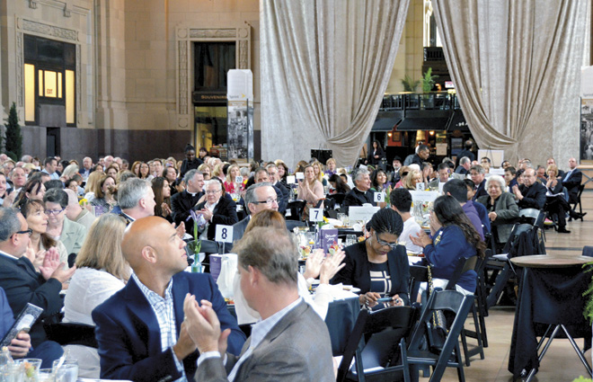 Attendees at the eighth annual School Bell Breakfast April 21 at Union Station applaud one of the St. Thomas Aquinas Award winners, the Cosentino family. (Marty Denzer/Key photo)