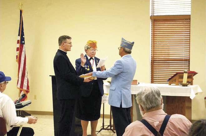 Installation of Post 1974 Commander John F. Kopp as National Director 3 Year. Vicar General Fr. Charles Rowe is holding the Bible. Commander Arminda Crawford is administering the oath to John F. Kopp. (Key Photo/courtesy Commander John Kopp)