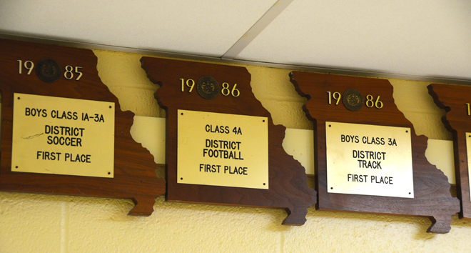 School sports memorabilia such as these district and conference plaques will be auctioned off. (Marty Denzer/Key photo)