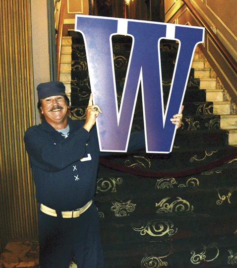 KayCee, the Royals' W guy, poses with that winning letter. (Marty Denzer/Key photo)