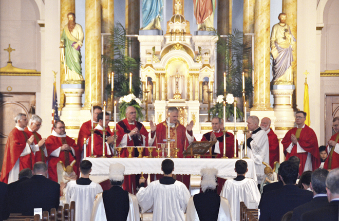 Bishop James Johnston, Jr., surrounded by Archbishop Joseph Naumann of Kansas City, Kan., and Bishop Thomas Paprocki of Springfield, Ill., and priests from both sides of the state line, prays during the Red Mass for Legal Professionals Oct. 28 at Our Lady of Sorrows Church. (Marty Denzer/Key photo)