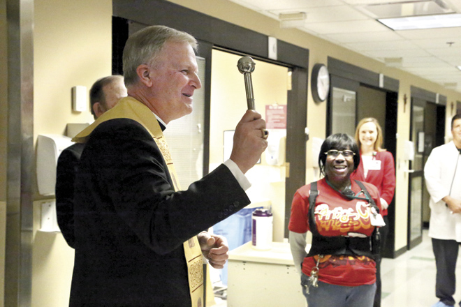 Bishop Johnston blesses staff, office equipment, walls, floors, windows and doors of St. Joseph Medical Center's ER  Dec. 16. (Megan Marley/Key photo)