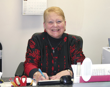 Elaine Ingle, Chair of the Catholic Charities Advisory Board for St. Joseph, provides a welcoming smile to those who visit. (Sara Kraft/Key photo)