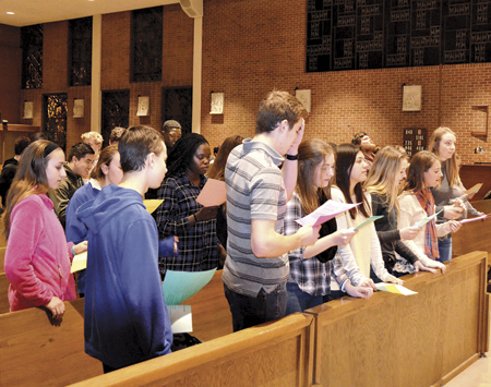Members of St. Gabriel Archangel parish Youth Group join in singing a hymn before reflecting on what Pro-Life means. (Marty Denzer/Key photo)