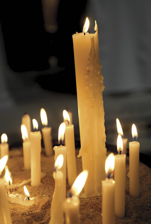 Candles carried in procession for the Mass of Innocents at St. Mary's Church in Independence. (Megan Marley/Key photo)