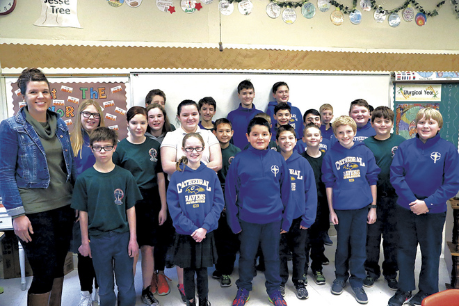 Colombian exchange student Santiago Garzon-Moya, center, surrounded by his Cathedral School classmates and teacher, Maggie Sego. (Megan Marley/Key photo)