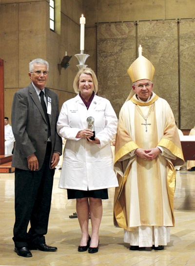 From L - R: Tom Liautaud, Mission Doctors, President of the Board of Directors, Dr. Gina Lawson and Archbishop José H. Gomez. (Photo courtesy Casey Ramsey, U.M.K.C.)