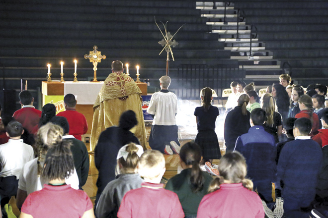Eucharistic Adoration wraps up each 5th Grade Vocation Day, as seen here on Feb. 23. (Megan Marley/Key photo)