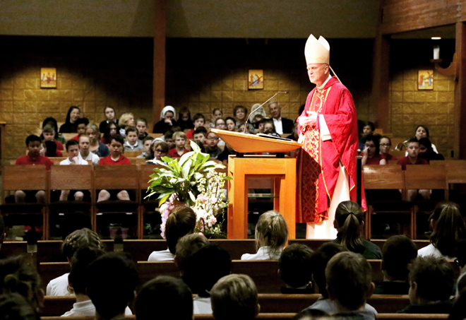 Bishop James V. Johnston, Jr. speaks to fifth graders gathered at St. John Francis Regis Parish for Vocation Days Mass on February 23. (Megan Marley/Key photo)