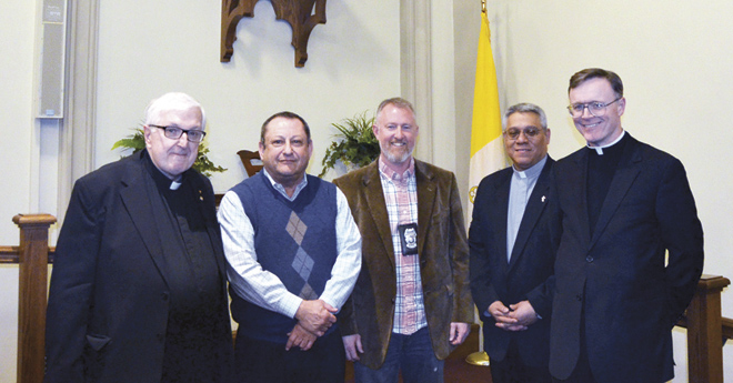 Grouped in friendship following Pray KC at Guardian Angels Church  Feb. 21 are from left, Jesuit Father Bob Hagan, Marvin Szneler, Sgt. Jason Cooley, Deacon Tyrone Gutierrez and Father Charles Rowe. (Marty Denzer/Key photo)