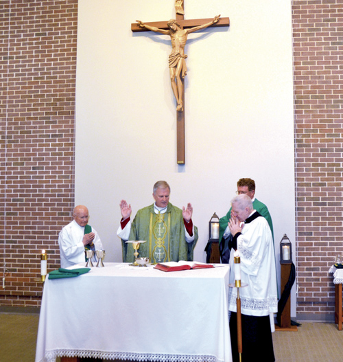 Bishop Johnston celebrating the Liturgy of the Eucharist in Orscheln Memorial Chapel at Avila University Feb. 13. (Marty Denzer/Key photo)