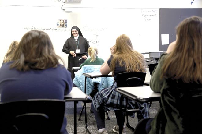 Sister Isabel Granados of the Sister Servants of Mary speaks on vocations to a classroom of girls at Vocations Days. (Megan Marley/Key photo)