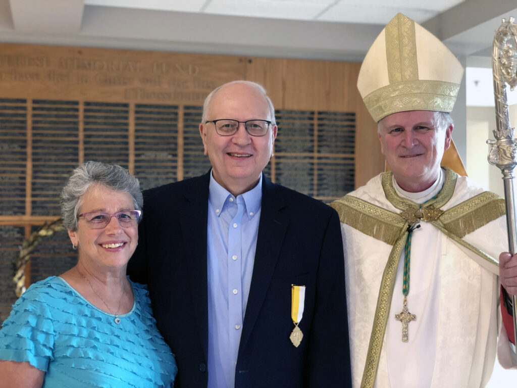 Retiring finance officer receives papal honor